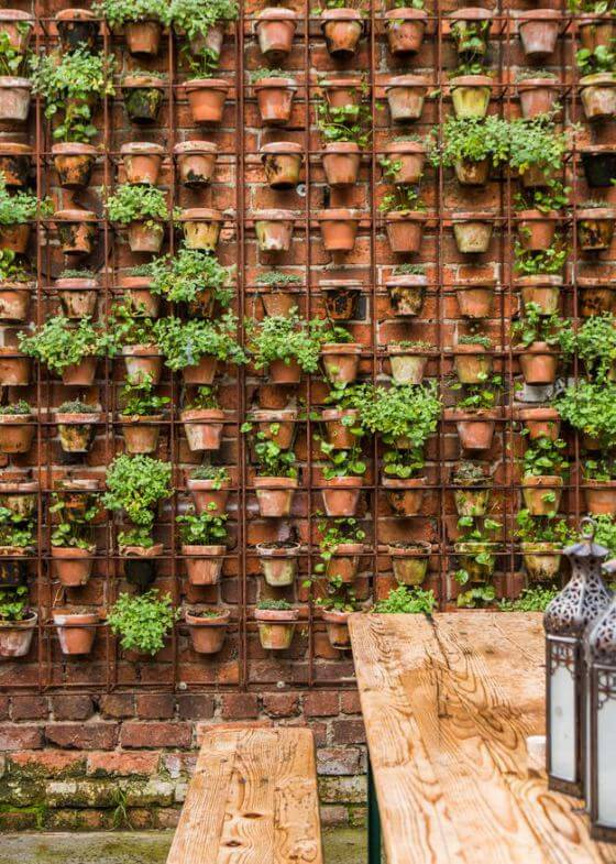 fazer jardim vertical com vasos
