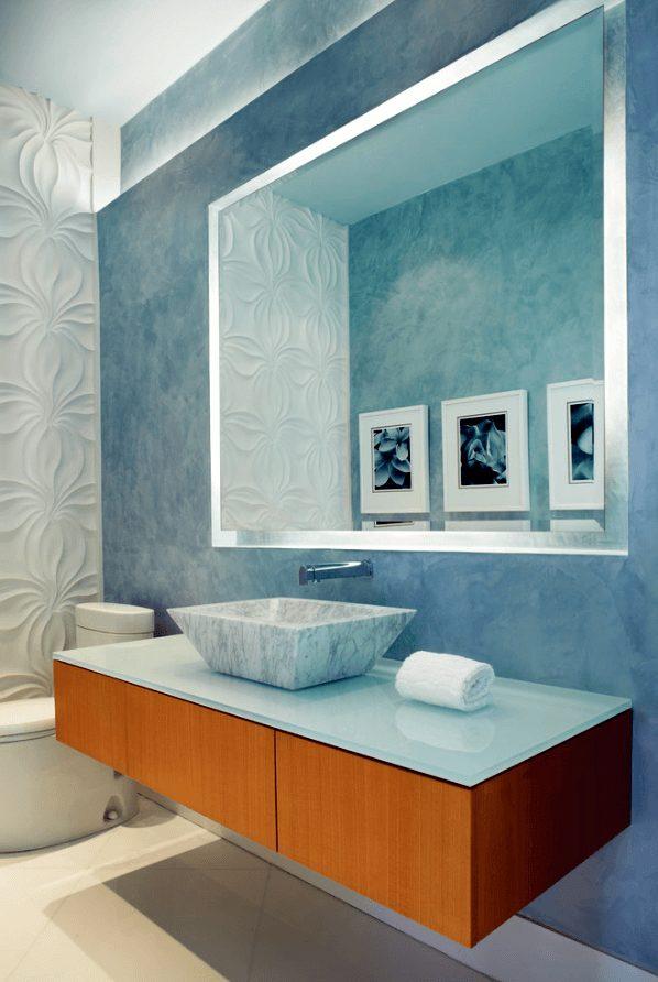 banheiro moderno com piso de seixo